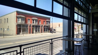 In the tap room, the door-windows open to a view of Broadway Street.