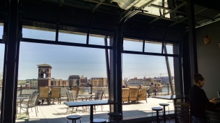 The door-windows open to a rooftop patio with a view of the old train depot and the Fox River.