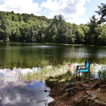 A chair, a lake, and fishing.