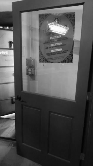 Unsecured, breakable door.