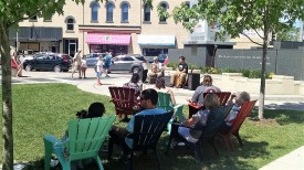 Music in Houdini Plaza. The other musicians are interspersed between the vendors on College Avenue.
