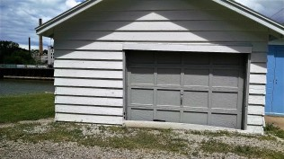 I have no idea what this garage was for. It was on the corner, not attached to anything.