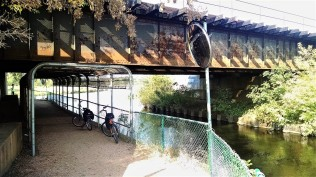 Under the railroad tracks we go. Note the mirror to help bikers see around the bend.
